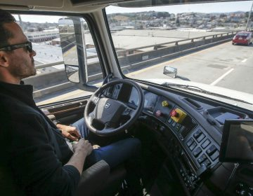 In this Thursday, Aug. 18, 2016, file photo, Matt Grigsby, senior program engineer at Otto, takes his hands off the steering wheel of a self-driving, big-rig truck during a demonstration on the highway, in San Francisco. (AP Photo/Tony Avelar, File)
