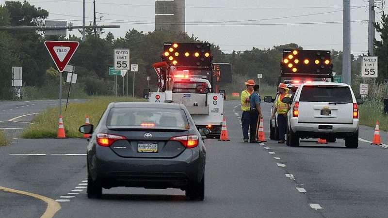 DelDOT trucks block access to southbound Rt. 1 near Dewey Beach after a dune breached allowed ocean water to cover the highway Tuesday morning.