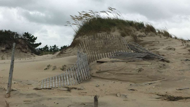 Dune fences damaged by high water forced on shore by Hurricane Jose.
