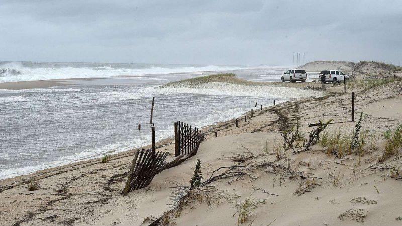 Dune breach floods Delaware highway