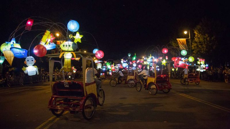 Pedicabs adorned with colorful lanterns perform a dance on the Ben Franklin Parkway to kick off the 100th anniversary of the Parkway. (Emily Cohen for NewsWorks)