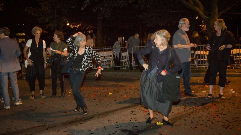 Ladies dance to the music on the Parkway after the debut of ''Cai Guo-Qiang: Fireflies'' on the Ben Franklin Parkway. (Emily Cohen for NewsWorks)