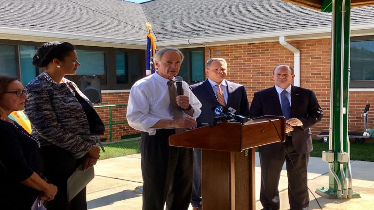U.S. Sens. Chris Coons and Tom Carper spoke out against the latest GOP health care bill at a press conference outside the VA Medical Center in Wilmington. (Zoë Read/WHYY)