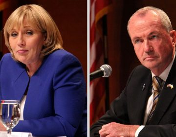Two candidates, both seated at table, with microphone; Guadagno in blue suit (left) Murphy in black (right)