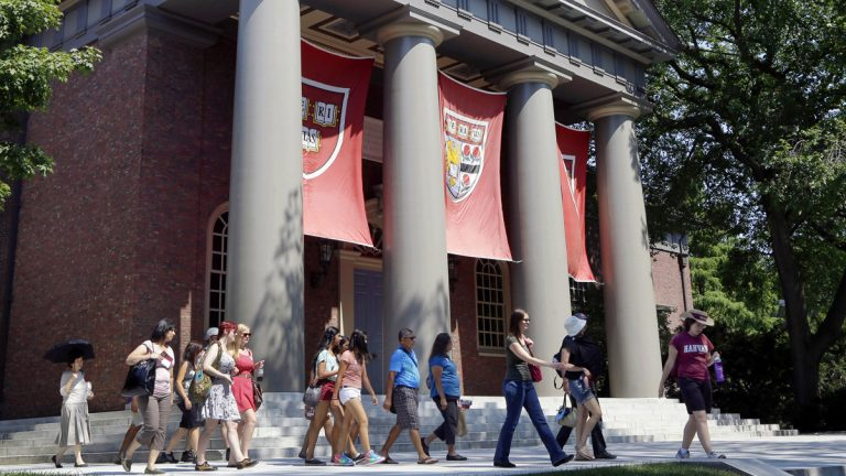 A tour group is shown walking through the campus of Harvard University in Cambridge, Mass. Word of an August 2017 Justice Department inquiry into how race factors into admissions at Harvard University has left top-tier colleges bracing for scrutiny of practices that have boosted diversity levels to new highs. (AP Photo/Elise Amendola, File)