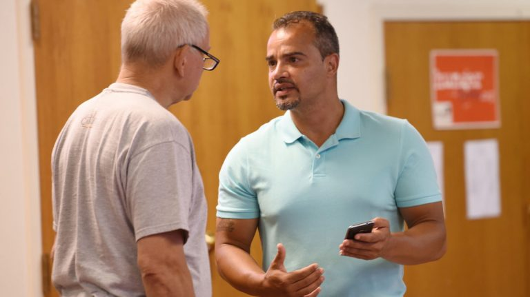 Mentor Frantz Herr (left) and returning citizen Isaac Rivera (right) have a discussion before the Lancaster County re-entry program at the Ebenezer Baptist Church Wednesday, Aug. 2, 2017, in Lancaster, Pennsylvania. (Bradley C. Bower/Philadelphia Inquirer)