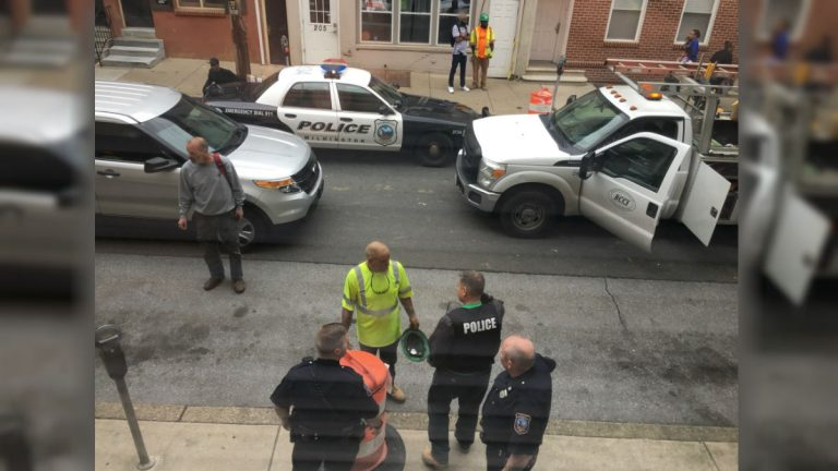 Police investigate a shooting on 7th St. in May. A 13-year-old boy was arrested after a brief chase. (Mark Eichmann/WHYY)