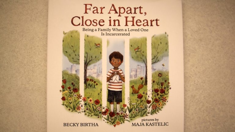 The cover of local author Becky Birtha's book evokes prison bars because it focuses on kids coping when their parents are incarcerated. (Emma Lee/WHYY)