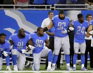 Detroit Lions players take a knee during the national anthem before an NFL football game against the Atlanta Falcons, Sunday, Sept. 24, 2017, in Detroit.