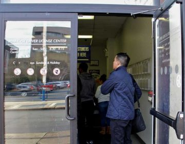 Customers line up at the PennDOT Driver License Center at Eight and Arch streets in Philadelphia. (Emma Lee/WHYY, file)