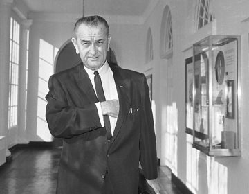 President Lyndon Johnson walks from his office in the White House to a studio in the Executive Mansion to address the nation on the bombing of North Vietnam, Jan. 31, 1966. (AP Photo, file)