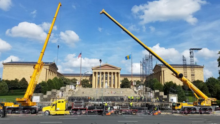 Workers set up the stage for the Made in America concert on the Ben Franklin Parkway. (Peter Crimmins/WHYY)