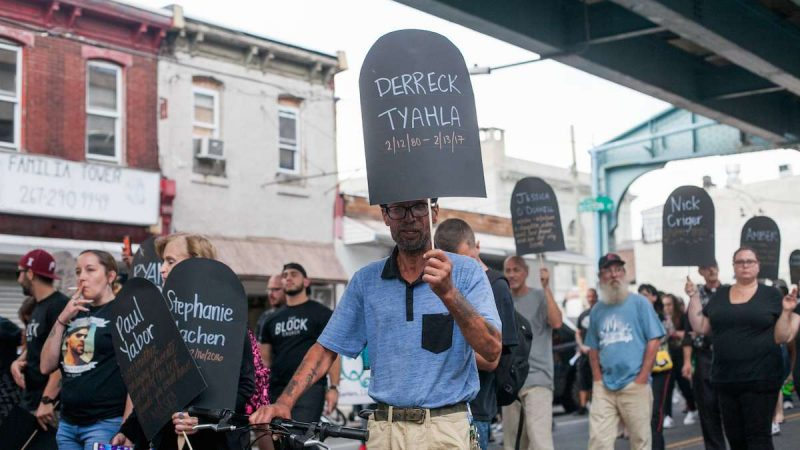 Hundreds march up Kensington Avenue Thursday for the March in Black in remembrance of those who have died from opioid overdoses. (Brad Larrisonf or NewsWorks)