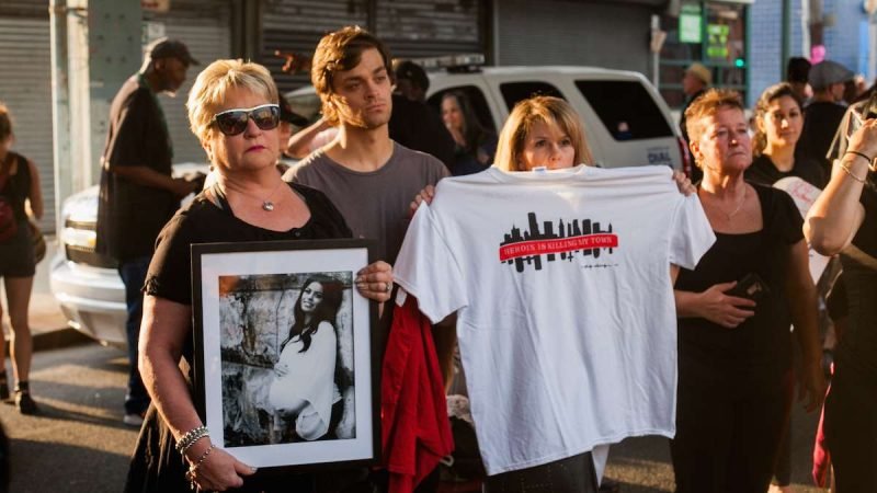 Donna Morgan, (left), stands with a picture of her daughter Brittany who died of a heroin overdose in May 2017 along with her son Nathan and friend Robin D'Angleo whose son is in recovery for heroin addiction. (Brad Larrison for NewsWorks)