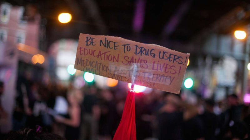 A sign at the March in Black reads, 'Be nice to drug users! Education Saves Lives!' (Brad Larrison for NewsWorks)