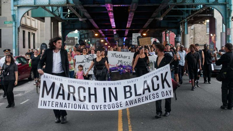 Hundreds march up Kensington Avenue Thursday for the March in Black in remembrance of those who have died from opioid overdoses. (Brad Larrison for NewsWorks)