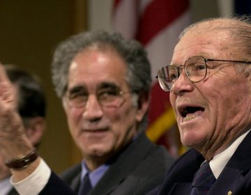 Robert McNamara, right, defense secretary under Presidents Kennedy and Johnson, is shown in 2001 at a forum at the John F. Kennedy School of Government at Harvard University in Cambridge, Mass. (AP Photo/Steven Senne, File)
