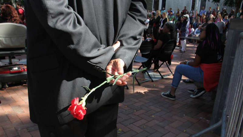 Members of Temple Student Government and Progressive NAACP, who organized the memorial service, passed out red carnations to attendees.