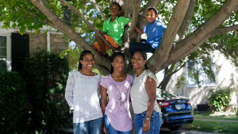 Jameria Miller, (left), pictured with her mother Jamella, sister Kene, brother Bryant and cousin Braylon at their Landsdowne home. The Millers are featured in an upcoming documentary on the National Geographic Channel. (Brad Larrison for NewsWorks)