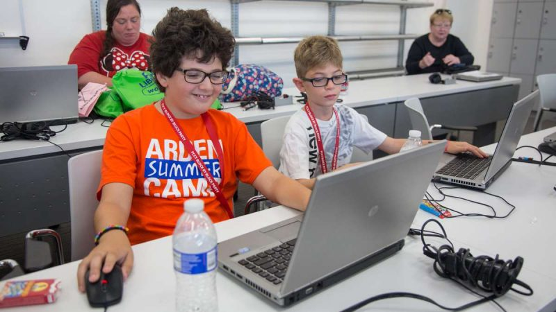 10-year-olds Vittorio Trotta (left) and Paul Ricchiuti work on their Minecraft creation together at the inaugural Block by Block Party, a Minecraft gaming event and family science festival at USciences benefiting Philadelphia Public Schools.