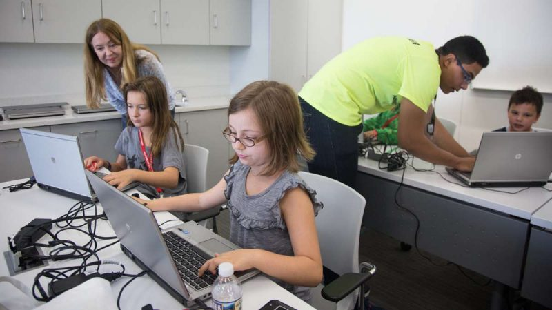 10-year-olds Zoe DePaul (center) and Lindsay McGinley work on their Minecraft creation together at the inaugural Block by Block Party, a Minecraft gaming event and family science festival at USciences benefiting Philadelphia Public Schools.