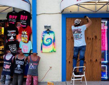 Jone Yoon boards up his beach souvenir shop ahead of Hurricane Irma in Daytona Beach, Fla., Thursday, Sept. 7, 2017. (AP Photo/David Goldman)