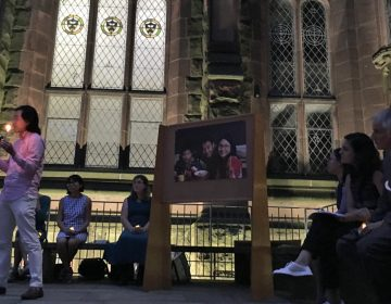 Zhan Zhang, a friend of Xiyue Wang, speaks during a vigil calling for his release (Jeanette Beebe for WHYY)