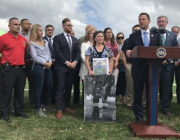Pennsylvania Attorney General Josh Shapiro, flanked by people whose loved ones have been addicted to opioids, announces new details of a 41-state investigation into the role of pharmaceutical companies in the opioid epidemic. (Laura Banshoff/WHYY)