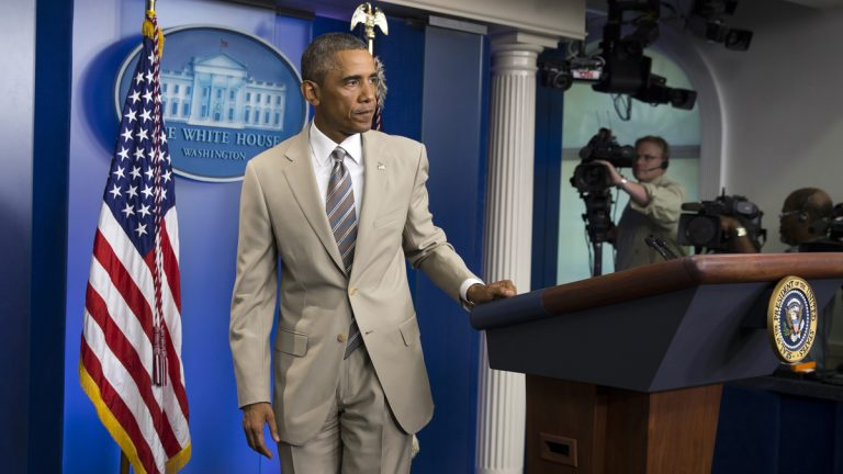 In this Thursday, Aug. 28, 2014 file photo, President Barack Obama leaves after speaking about the economy, Iraq, and Ukraine, in the James Brady Press Briefing Room of the White House in Washington, before convening a meeting with his national security team on the militant threat in Syria and Iraq. Obama's summer fashion choice, not unprecedented among presidents - himself included - was the talk of social media, Thursday. Other presidents who have taken on tan include Bill Clinton, Ronald Reagan, George H. W. Bush, George W. Bush and Dwight Eisenhower. (AP Photo/Evan Vucci, file)