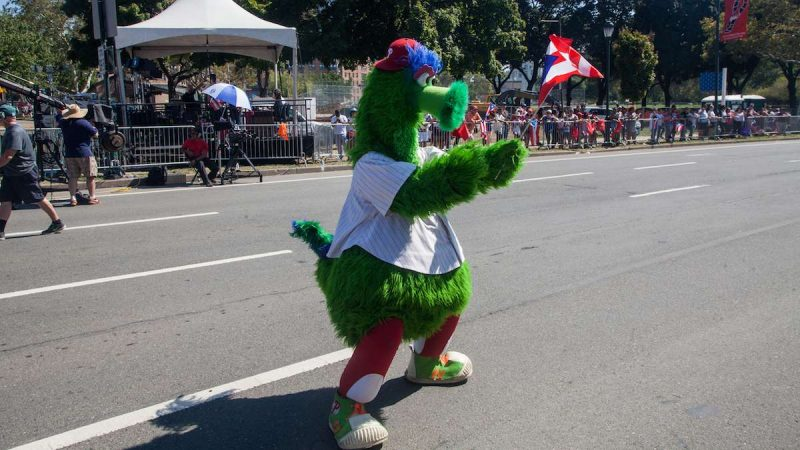 The Phillie Phanatic dances on the Benjamin Franklin Parkway during the 2017 Puerto Rican Day Parade.
