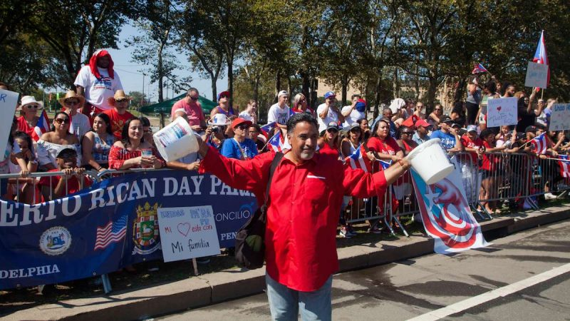 Donations for hurricane recovery are collected during the 2017 Puerto Rican Day Parade.