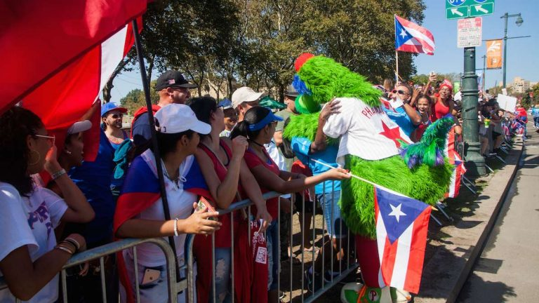 The Phillie Phanatic gives hugs on the Benjamin Franklin Parkway during the 2017 Puerto Rican Day Parade.