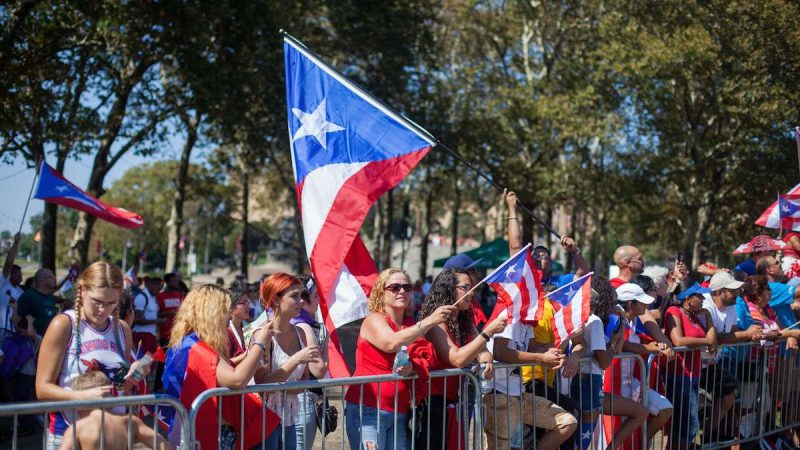 The 2017 Puerto Rican Day Parade on the Benjamin Franklin Parkway celebrates the island's culture and calles for charity to aid in its recovery following the damage caused by Hurricane Maria. (