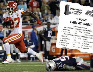 Kansas City Chiefs running back Kareem Hunt (27) eludes New England Patriots defensive end Cassius Marsh (55) as he runs for a touchdown after catching a pass from Alex Smith during the second half of an NFL football game, Thursday, Sept. 7, 2017, in Foxborough, Mass. (AP Photo/Steven Senne; Parlay card inset photo via DoverDowns/Delaware Lottery)