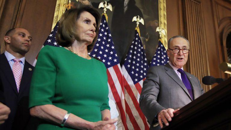 Senate Minority Leader Chuck Schumer of N.Y., right, with House Minority Leader Nancy Pelosi of Calif. and Rep. Hakeem Jeffries, D-N.Y., back left, speaks to reporters on Capitol Hi