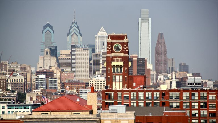 Census data show that poverty in Camden (foreground)is ebbing, while across the river in Philadelphia, the poverty rate remains flat. (Emma Lee/WHYY, file)