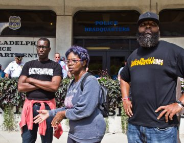 Asa Khalif, organizer of Black Lives Matter's Philadelphia chapter, Rowena Faulk, and Isaac Gardner, protested outside police headquarters Thursday to demand murder charges be brought against officer Pownall.