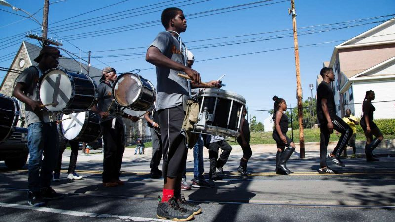 The Mass Konfusion drill team briefly marches in place before continuing on. (Annie Risemberg for NewsWorks)