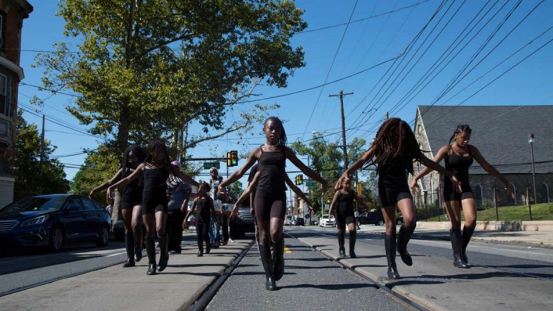 The Mass Konfusion drill team makes their way down Woodland Avenue during the Southwest Pride Day parade. (Annie Risemberg for NewsWorks)