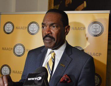 Philadelphia head of the NAACP Rodney Muhammad speaks at City Hall. (Tom MacDonald/WHYY)