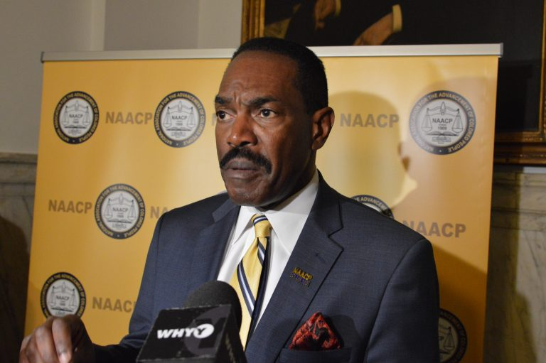 Philadelphia head of the NAACP Rodney Muhammad speaks at City Hall. (Tom MacDonald/WHYY)