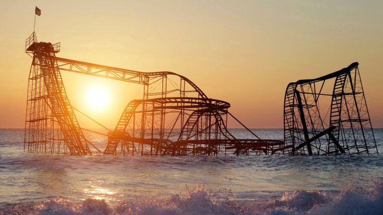 FILE - In this Feb. 25, 2013 photo, the sun rises in Seaside Heights, N.J., behind the Jet Star Roller Coaster which fell into the ocean during Superstorm Sandy. In May 2013 it was dismantled and removed. (AP Photo/Mel Evans, File)