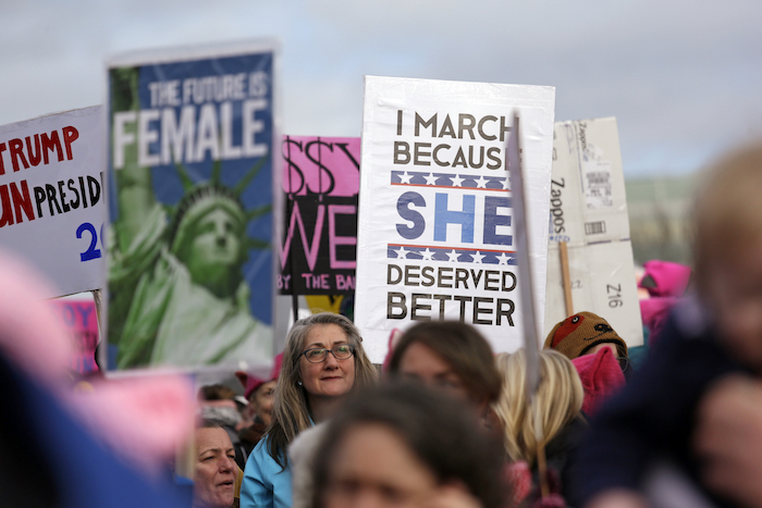 Protesters crowd a park to overflowing for a rally before a women's march Saturday, Jan. 21, 2017, in Seattle. Women across the Pacific Northwest marched in solidarity with the Women's March on Washington and to send a message in support of women's rights and other causes. (AP Photo/Elaine Thompson)
