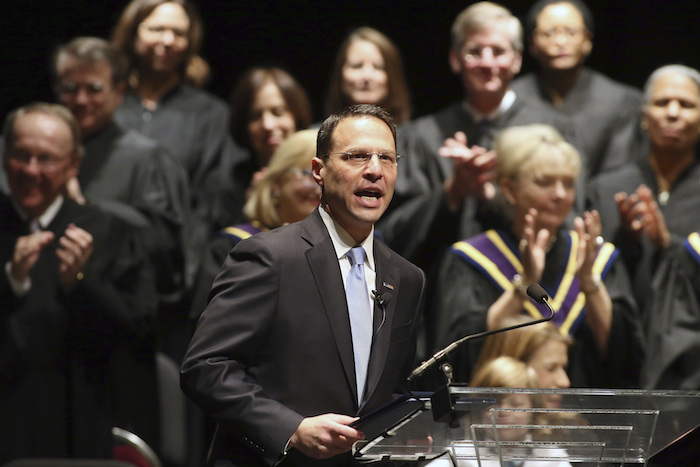 FILE- In this Jan. 17, 2017, file photo, Josh Shapiro speaks to the crowd after being sworn in as Pennsylvania's attorney general in Harrisburg, Pa. Attorneys general from Pennsylvania, New Mexico and more than a dozen other states are urging U.S. Education Secretary Betsy DeVos to keep in place protections for victims of sexual assault on college campuses. (AP Photo/Chris Knight, File)