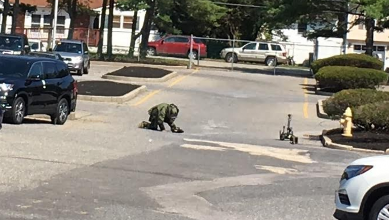 A state trooper examining what was discovered to be an imitation explosive device in Toms River Thursday morning. (Photo: Toms River Police Department)
