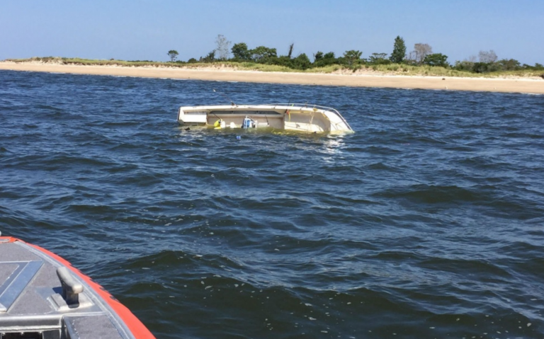 A capsized boat off Sandy Hook in Monmouth County Monday afternoon. (USCG image)