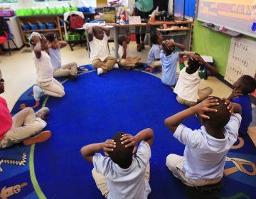 An elementary school teacher instructs students to put their hands over their heads. (AP File Photo/Manuel Balce Ceneta)