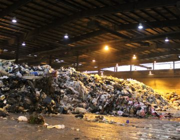 Trash piles up at Atlantic County Utilities Authority's warehouse (Bill Barlow for WHYY)