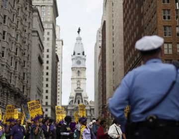 Members of Service Employees International Union march near City Hall in Philadelphia. (AP File Photo/Matt Rourke)