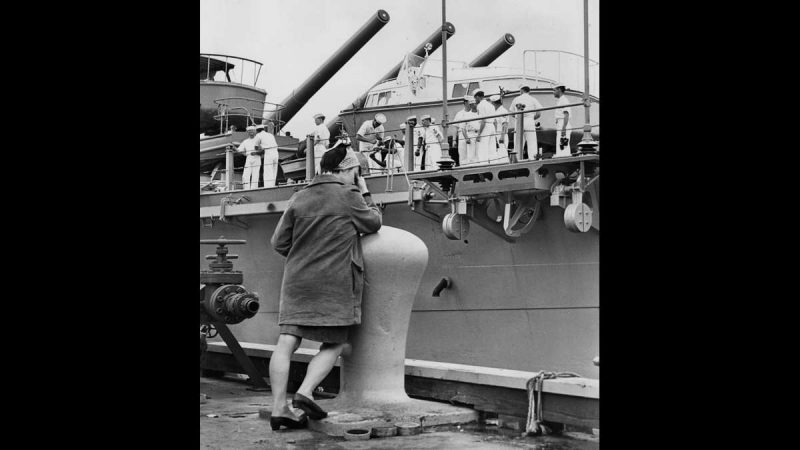 The U.S.S. New Jersey pulls away from the Philadelphia Naval Shipyard on May 16, 1968, to begin a tour of active duty as the downhearted girlfriend of one sailor covers her eyes. (Dominic Ligato / Courtesy of George D. McDowell Philadelphia Evening Bulletin Collection, Temple University Libraries)